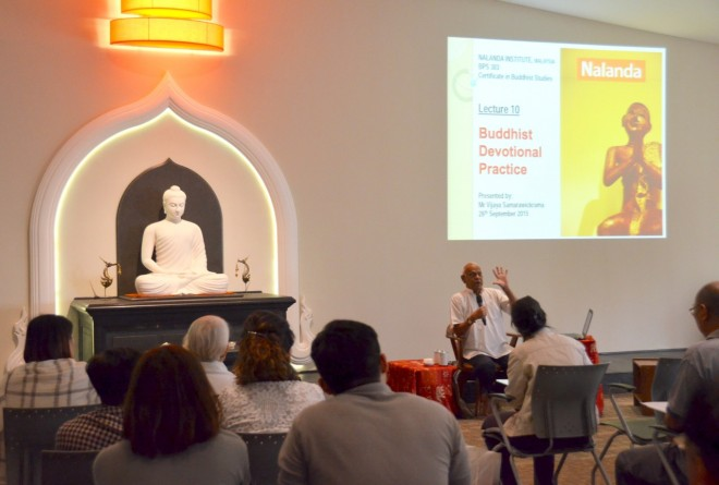 Uncle Vijaya giving a lecture on 'Buddhist Devotional Practice'.