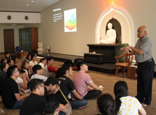 Participants listen keenly to Achariya Vijaya presenting an interesting Dhamma talk.