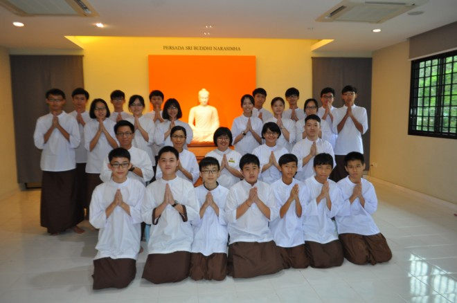 The Dhamma School students having a group photograph with their teachers after the examination.