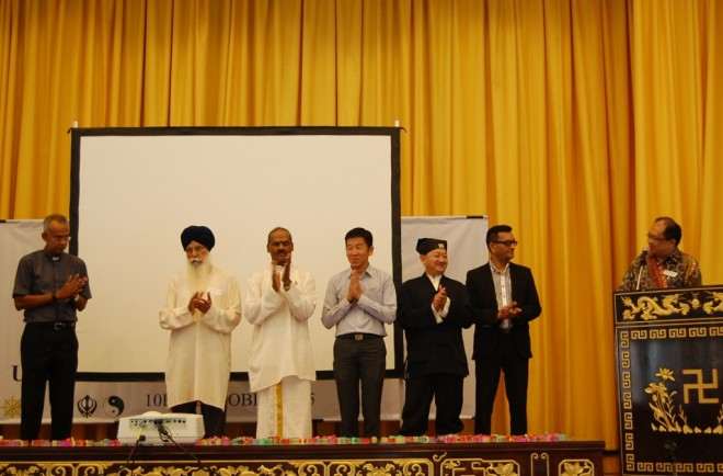 Representatives of various religions acknowledged on stage.