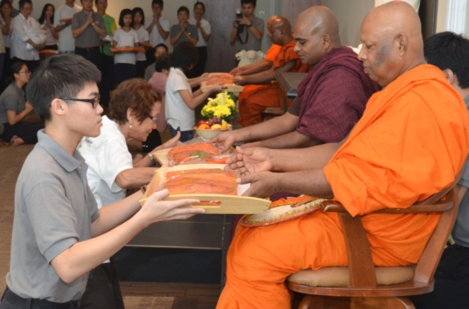 Young and old came to support the monastic community on Sangha Day.