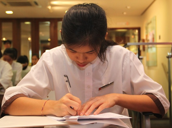 Students study hard to perform well in the exam.