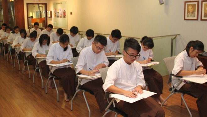 Dhamma School students sitting for their year-end examination.