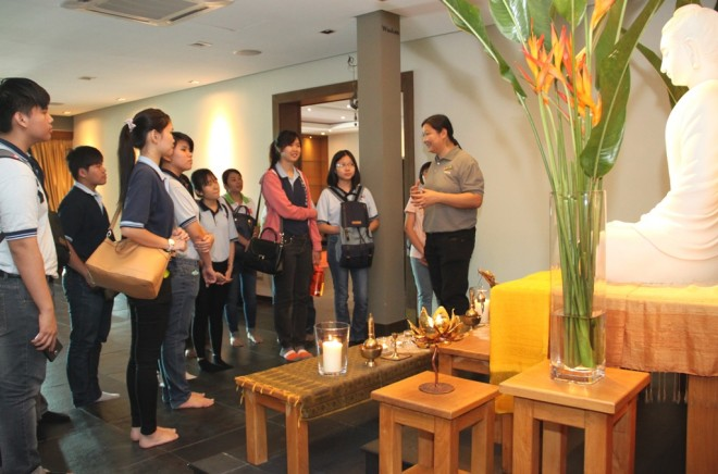 Sis. Buddhini takes some of the students on a tour of the Centre.