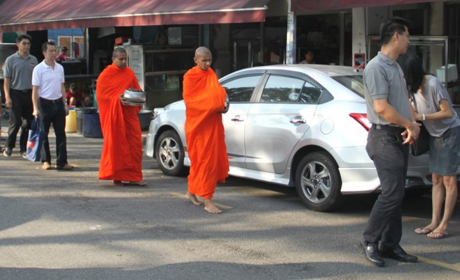 Venerable monks on alms-round at Sri Petaling and Happy Garden markets.