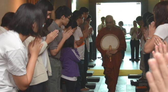 Devotees greeting Ven. Rewatha at Nalanda Centre on 'Service Sunday'.