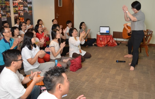 Sis. Nandini leading participants in a sing-along session.