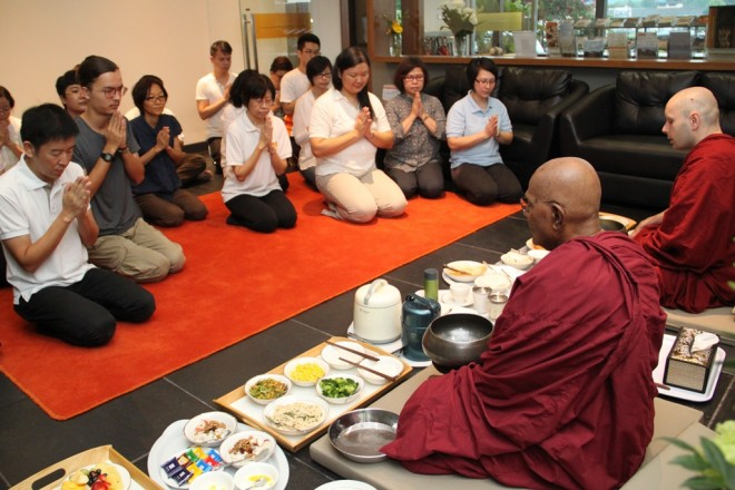 Devotees offering breakfast to Ven. Gunaratana and Ven. Mangala.