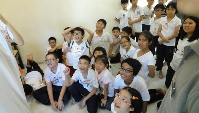 Junior Dhamma School students learning happily.