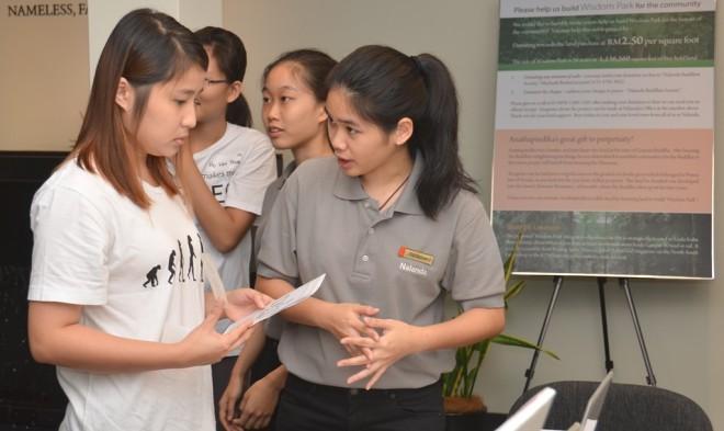 Participants making enquiries at the Help Desk.