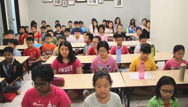 Nalanda Free School students do a short meditation before class.