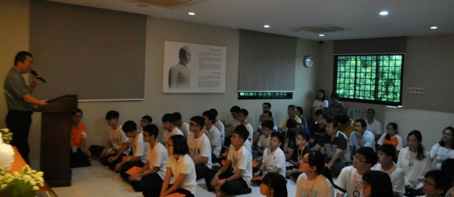 Welcoming students to the first session of Dhamma School.