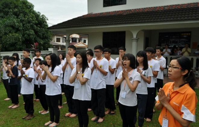 Flag-raising ceremony on the first day of Dhamma School.