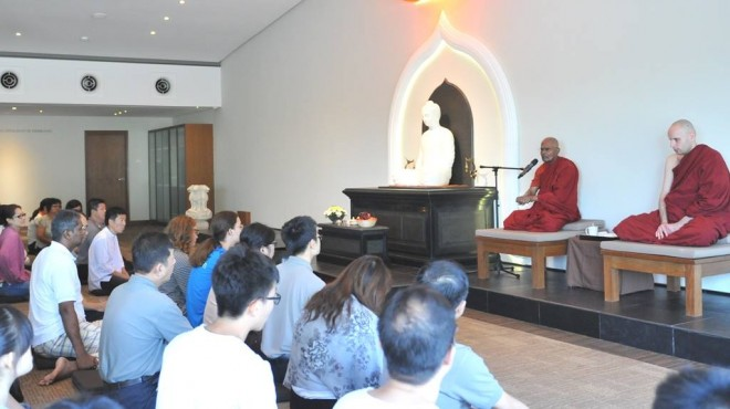 Venerable Gunaratana giving a Dhamma teaching; with him is Venerable Mangala (right).