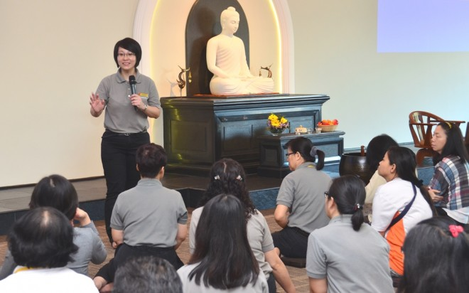 Sis. Nandini giving a talk on Buddhist etiquette and culture at the second session of the induction course.
