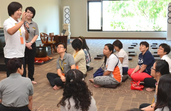 A participant sharing a story with her course mates.