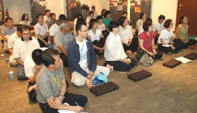 Devotees listening to Sis. Sandy's Dhamma sharing on the importance of concord and harmony.