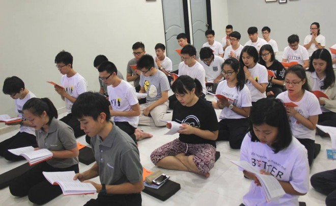 Youths beginning their morning service with chanting. It was a full-house at the Nalanda Youth Centre.