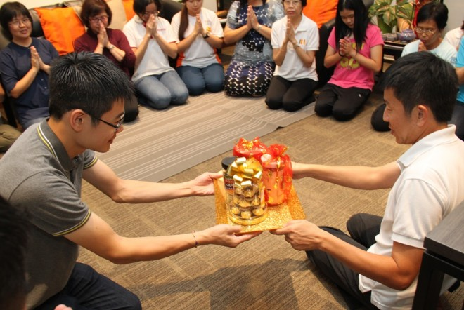 Nalandians presenting a token of appreciation to their teacher and mentor, Bro. Tan.