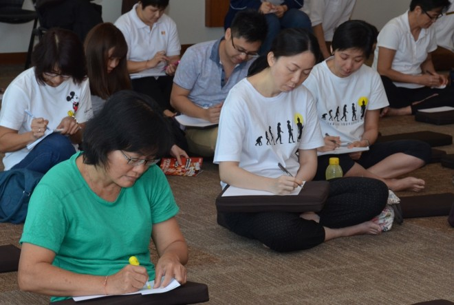 Participants writing letters to their loved one to express their gratitude.