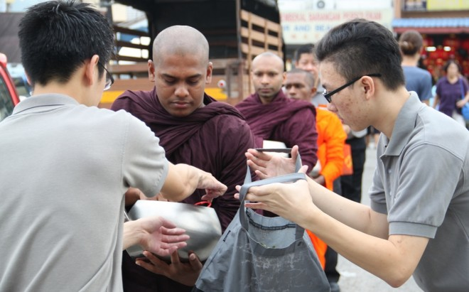 Nalanda volunteers accompanying the venerable monks on alms-round.