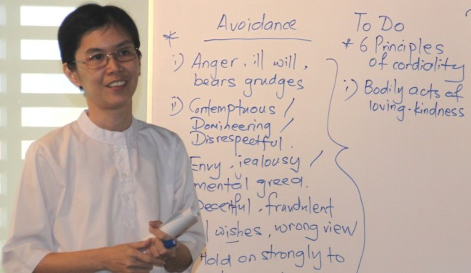 Sis. Santi giving a Dhamma sharing on how to avoid conflict.