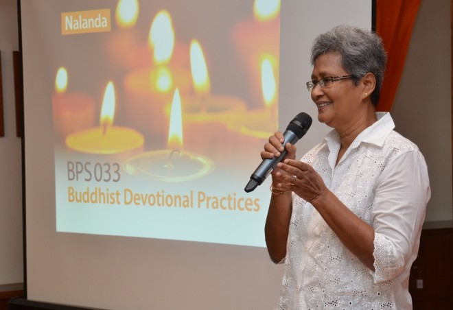 Sis. Paru sharing with the course participants on 'What is Buddhism?' and 'The Three Jewels'.