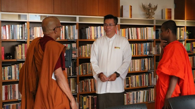Bro. Charlie showing the venerable monks around the Centre.