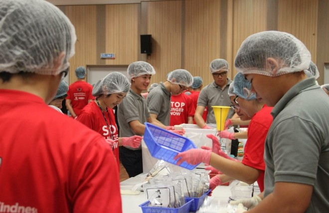 Youths helping to pack food parcels at the event.