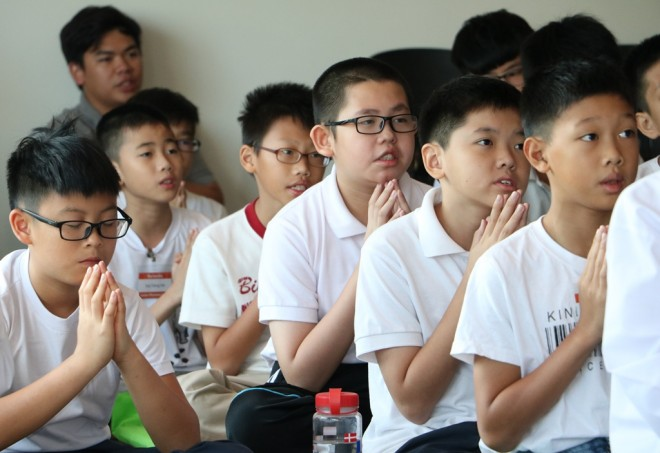 Dhamma School students attend Service Sunday before class.