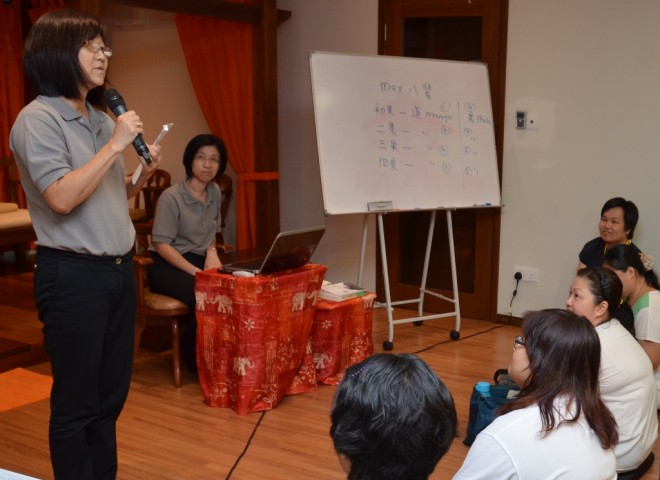 A group representative presents a summary of her group's discussion.