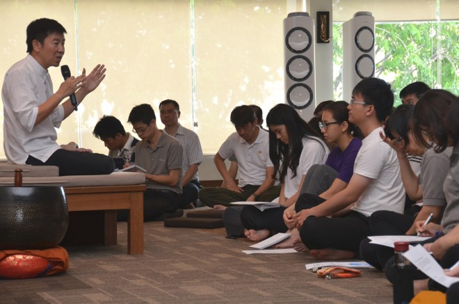 Bro. Tan giving a sharing as a follow-up to the recent camp's Dhamma sessions.