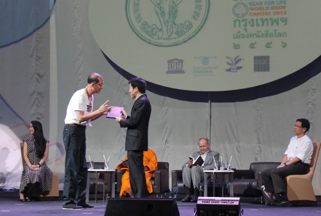 Bro. Tan receiving the book in Bangkok.