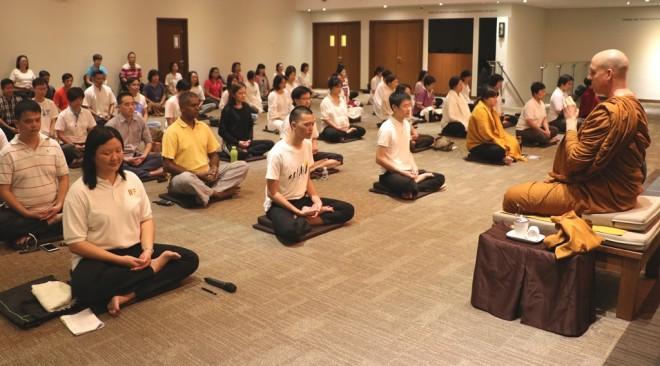 Ajahn Chandako conducting the weekly  meditation session at Nalanda Centre.