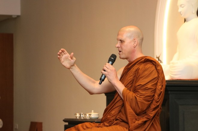 Venerable Ajahn Chandako giving a Dhamma talk after the weekly meditation session.
