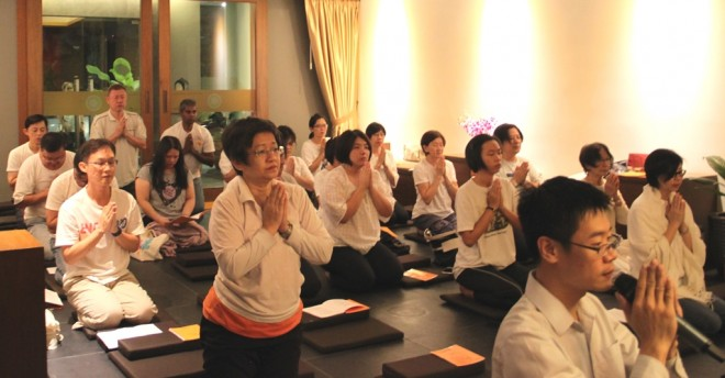Chanting before group meditation.