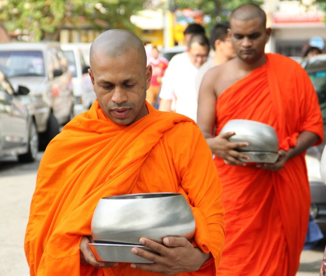 Venerable monks on alms-round at Overseas Union Garden (O.U.G.) and Happy Garden morning markets.