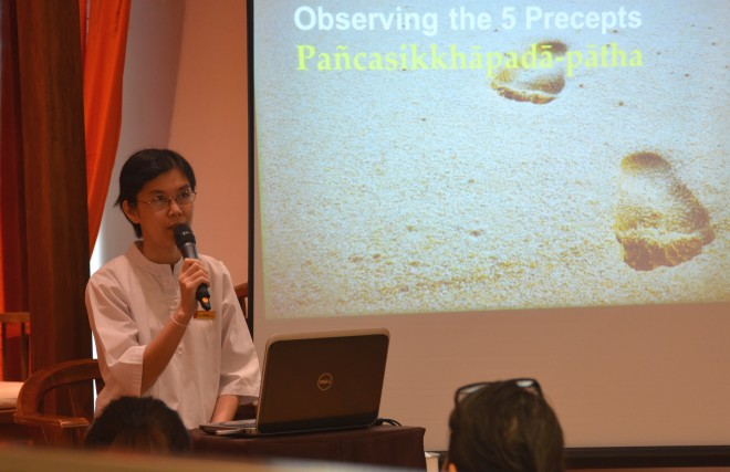Sis. Santi Cheang giving a talk on 'Observing the 5 Precepts.'