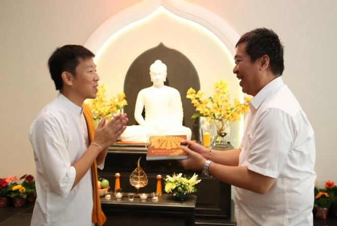Bro. Tan presenting the book to Bro. Rudy Ananda, representing the Buddhist community in Indonesia.