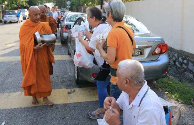 Devotees waited patiently for their turn to offer.