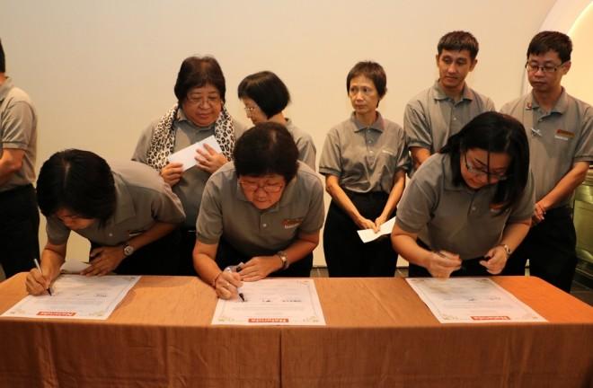 Branch Secretaries signing their service pledge.