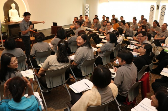"""Bro. Tan giving a talk on """"What is Leadership?"""" at the meeting."""