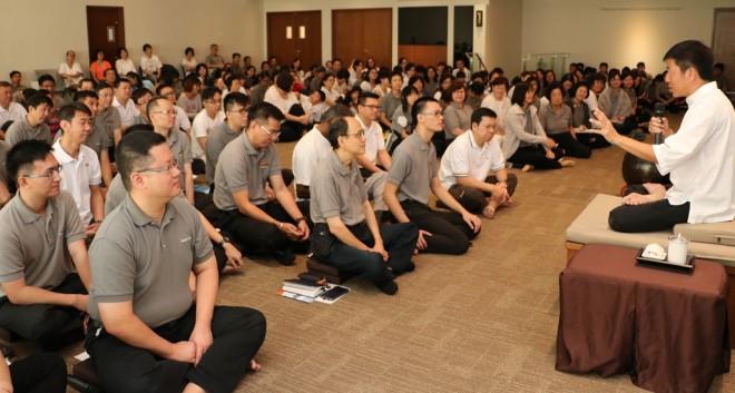 Bro. Tan giving a talk on unessential worldly gain versus essential spiritual gain.