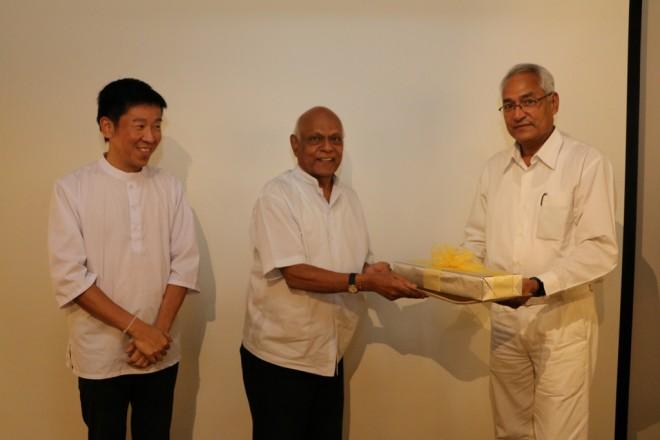 Chairman of Nalanda Education Committee Achariya Vijaya presenting a momento to Dr. Basanta Bidari.
