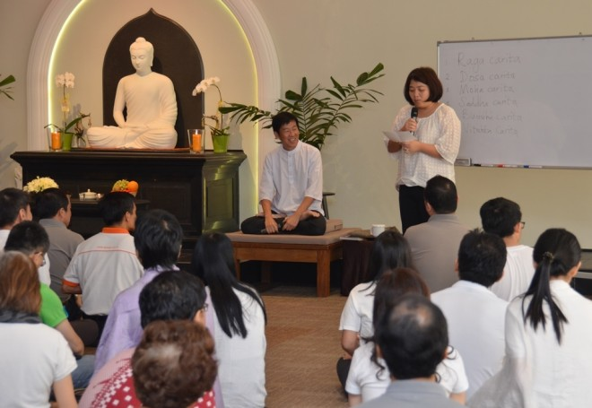 A devotee shares her thoughts during the Service Sunday Dhamma talk.