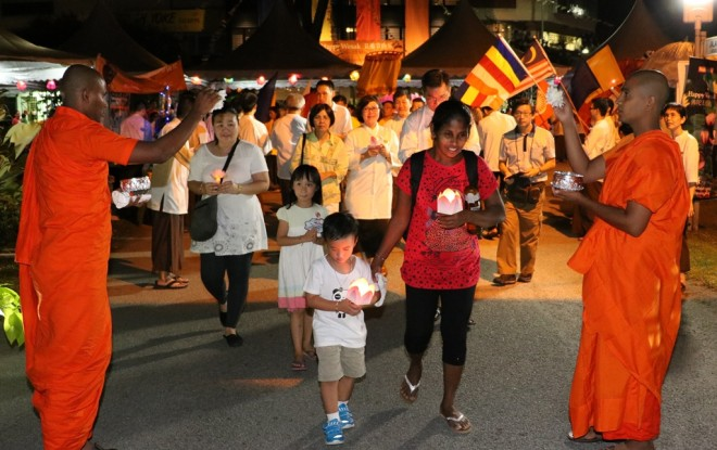 Members of the Sangha blessing devotees at 'the finishing line' as they completed the route of the procession.