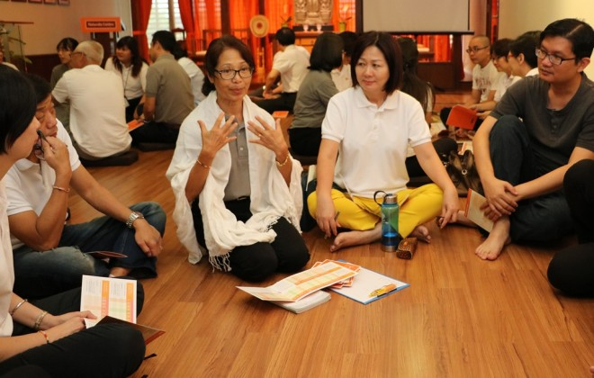 Participants have interesting group discussions following the Dhamma talk.