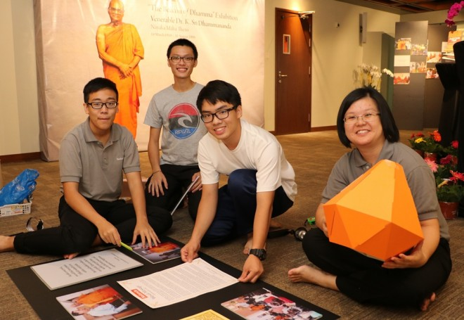 Volunteers preparing the exhibition hall on Wesak eve.