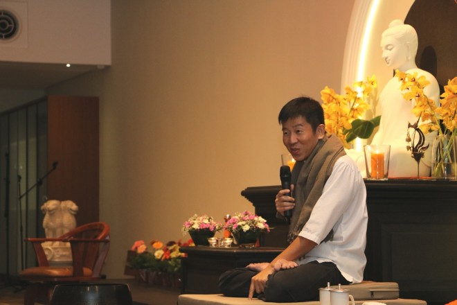 Bro. Tan giving a Dhamma talk on honouring the Buddha spiritually during Wesak.