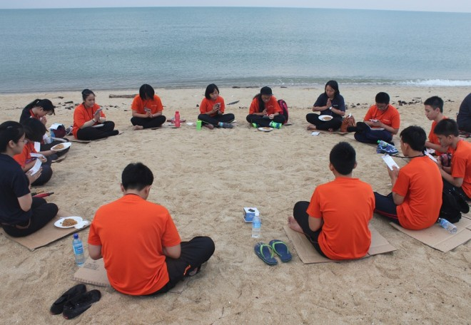 Resting and reflecting on Dhamma at the beach.